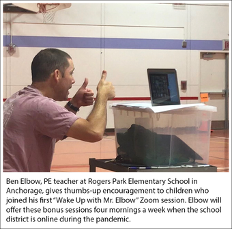 """Ben Elbow, PE teacher at Rogers Park Elementary School, Anchorage, gives thumbs-up to kids who joined his first """"Wake Up with Mr. Elbow"""" Zoom session"""