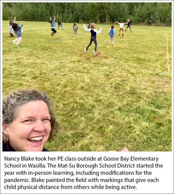 Nancy Blake at Goose Bay Elementary School, Wasilla painted an outdoor field with marks to keep class distanced while being active in her PE class