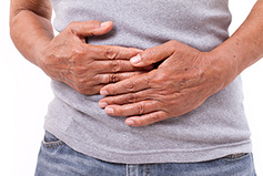 man hands on stomach