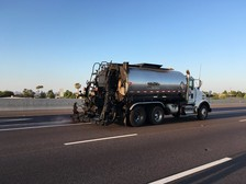 A spray truck is used to apply pavement sealant to extend the life of a Phoenix-area freeway (ADOT file photo)