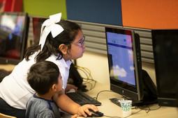 Kids at library computer