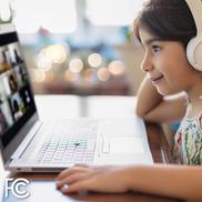 FCC Emergency Broadband Image - Girl on computer