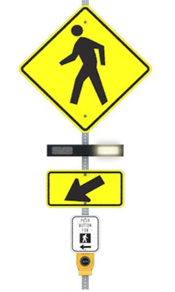 Yellow pedestrian yield sign and flashing light