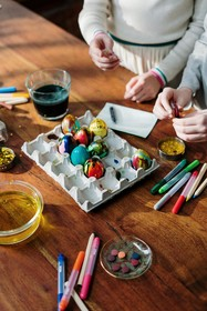 photo of children coloring eggs