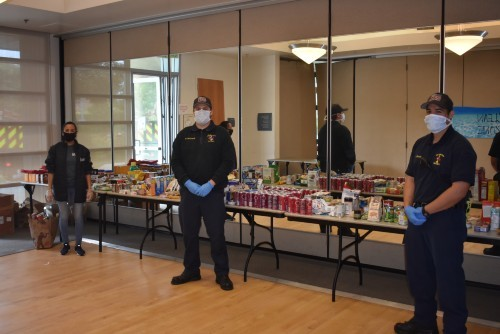 three staff members sort groceries for Culver City Emergency Food Drive