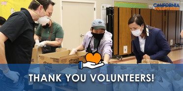 Thank you volunteers! People packing boxes of food