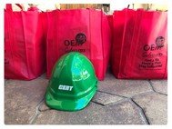red grocery bags with green CERT helmet