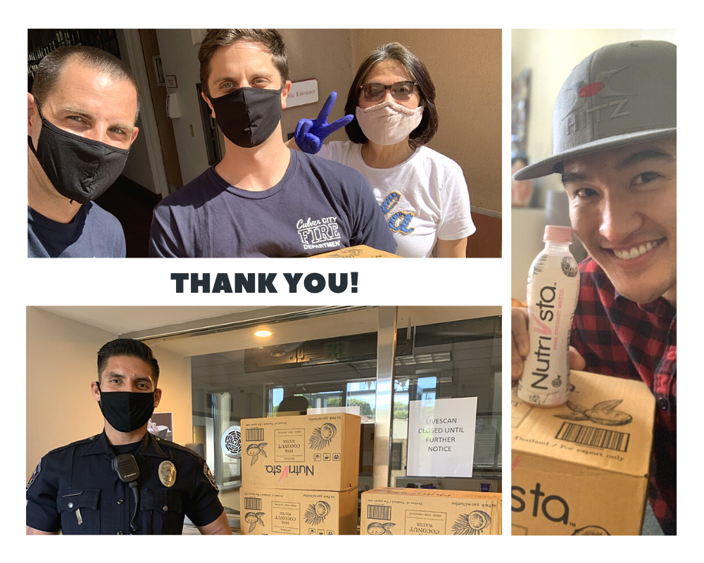 Thank you City employees holding boxes of donated coconut water