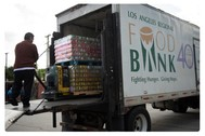 food being offloaded from a large truck