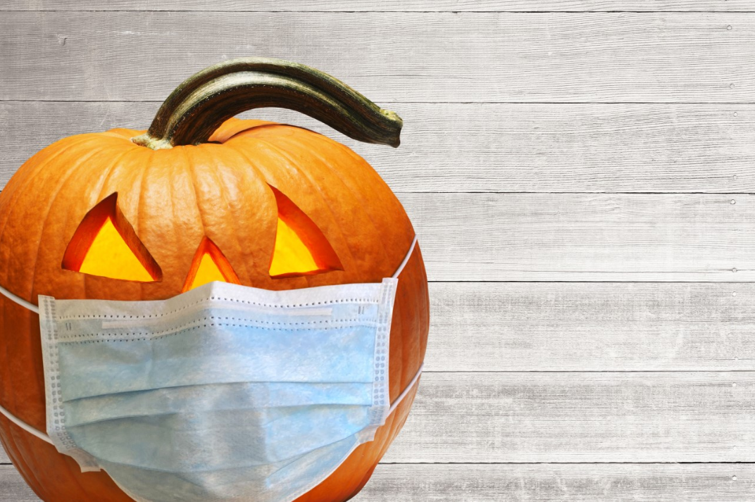 jack-o-lantern wearing a face covering