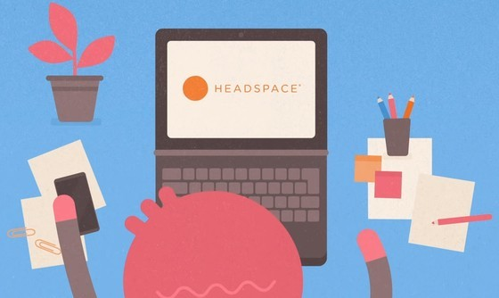 person working at a computer looking at Headspace App
