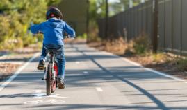 Child Biking on Trail