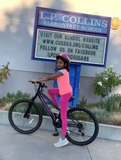 Biking Girl at Collins