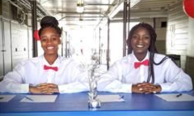 Two smiling hospitality students