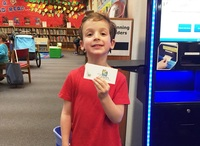 Library - child with card