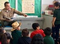 Sheriff Reading to Children