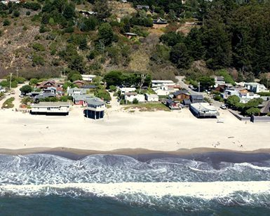 A view of a beachfront short-term rental property