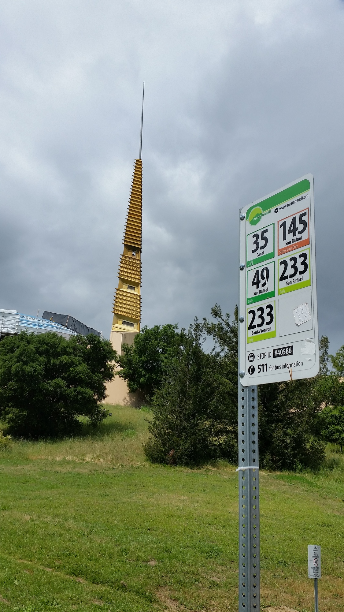 Marin Transit route sign in front of civic center's golden spire