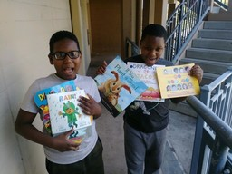 2 kids show off the books they received