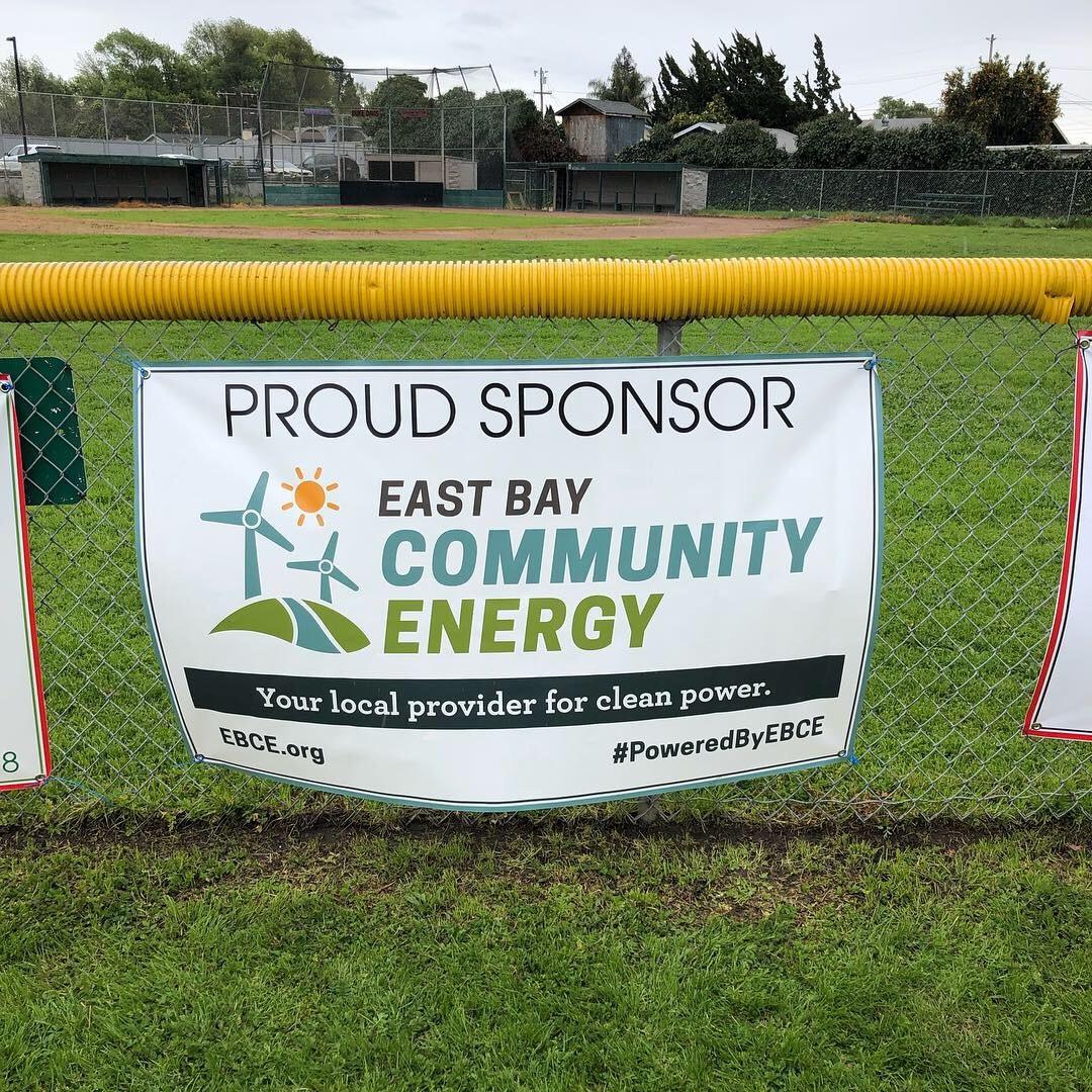 EBCE sign at little league baseball field