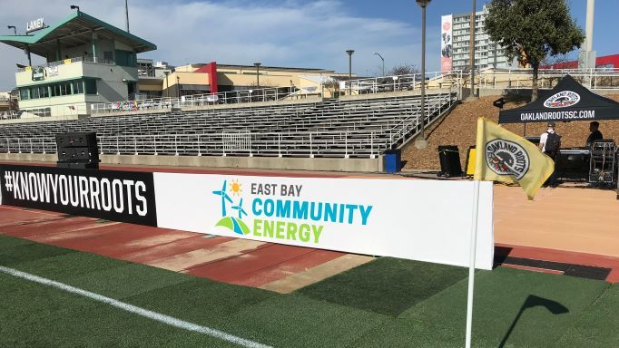 Oakland Roots and EBCE signs at Laney College stadium