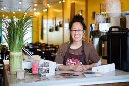 Business owner standing at counter