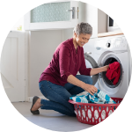 Person loading laundry machine
