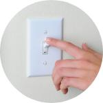 Hand on light switch