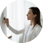 Person adjusting thermostat