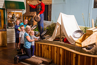 family at gold rush museum