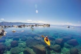 person on a kayak in lake tahoe