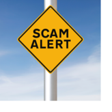 """A yellow traffic sign that says, """"scam alert."""""""