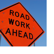 """Construction sign that says, """"road work ahead."""""""