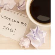 """A note sitting among scrunched up balls of paper and a cup of coffee. The note says, """"looking for a job!"""""""