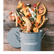 """Fruit and vegetable scraps fall into a bucket that says, """"compost."""""""