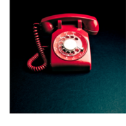Red rotary dial phone.