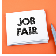 """A notecard that says, """"job fair"""" sits next to a black marker."""