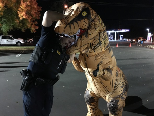 Officer with his head in a T-Rex's (custumed character's) mouth