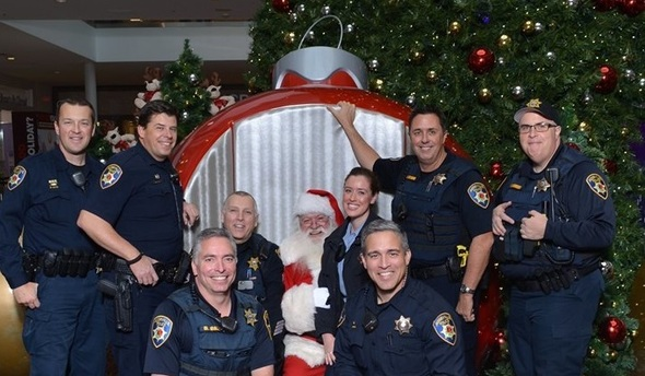 Officers and police staff with Santa Claus