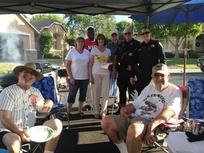 Neighborhood barbecue with police and neighbors