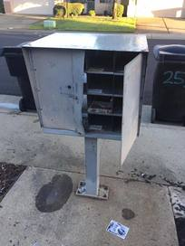 Community mailbox with back door pried open