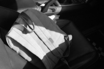 Backpack on the passenger seat of a car