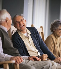 Senior citizens laughing and talking together