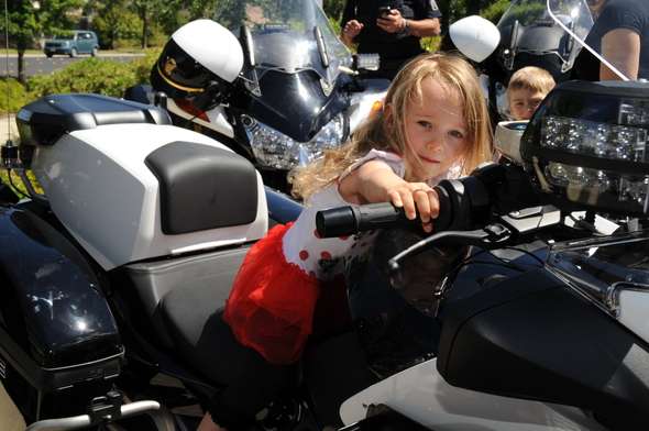 Close-up of a little girl on a police motorcycle
