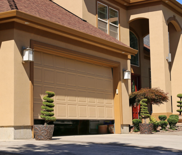 garage-part-way-opened-stucco-house_crop.png