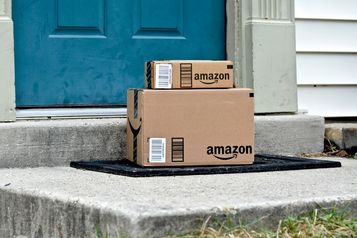 Amazon boxes on front porchstep