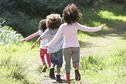 Three Little Girls Running in Park