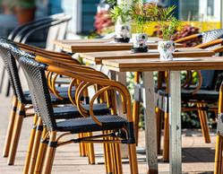Empty restaurants chairs on sidewalk