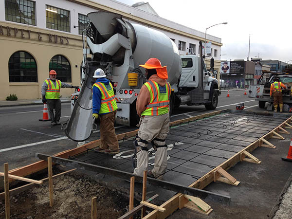 Construction of a bus boarding island during Phase 1 of the 8th Street Safety Project