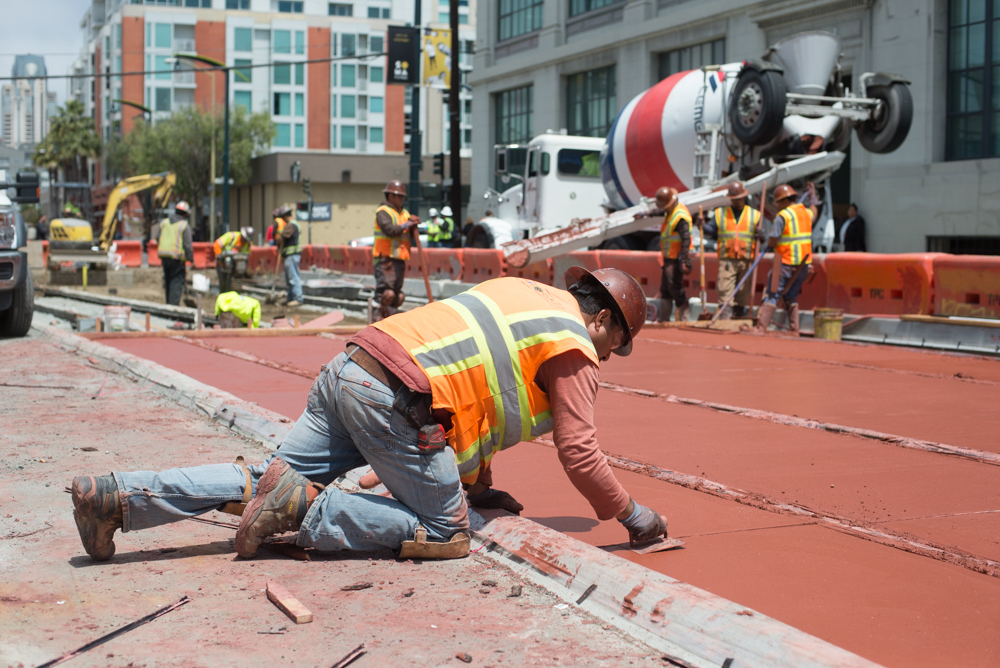 Concrete is being poured to build the topping slab along the surface alignment south of Brannan on 4th Street.